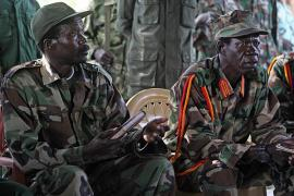 At the beginning of the Juba negotiations, Joseph Kony and his deputy Vincent Otti sit inside a tent at Ri-Kwamba in Southern Sudan. Photo credit: CSMonitor.